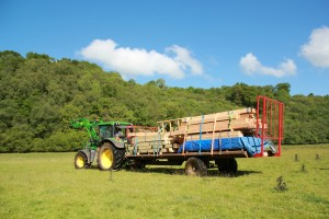 Tractor pulling flat pack cabin